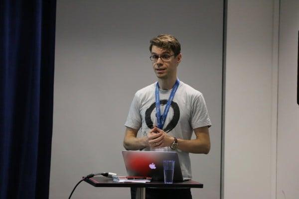 Björn delivers his talk on software development priorities