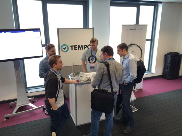 Tempo team demoing at the booth